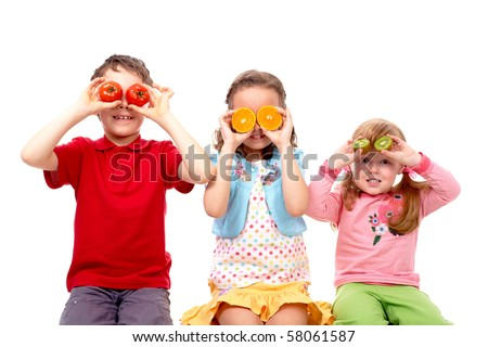 Portrait of three friends with vegetables and fruits before eyes - stock photo