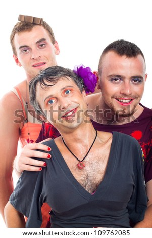 Portrait of three funny transvestites, isolated on white background. - stock photo