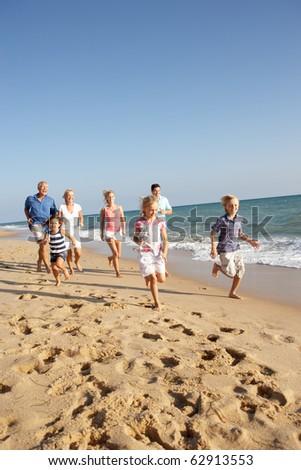 Portrait Of Three Generation Family On Beach Holiday - stock photo
