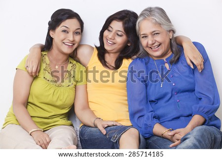 Portrait of three generation family sitting together - stock photo