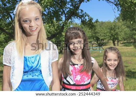 Portrait of three girl friends in forest - stock photo