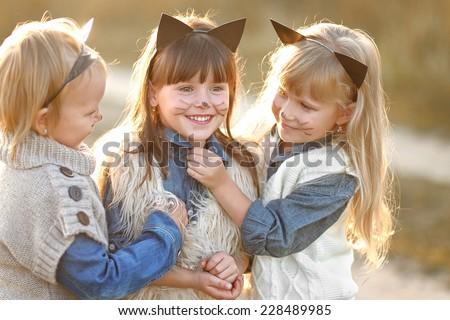Portrait of three girls in the woods girlfriends - stock photo