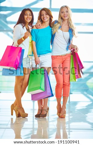 Portrait of three glamorous girlfriends with paperbags - stock photo
