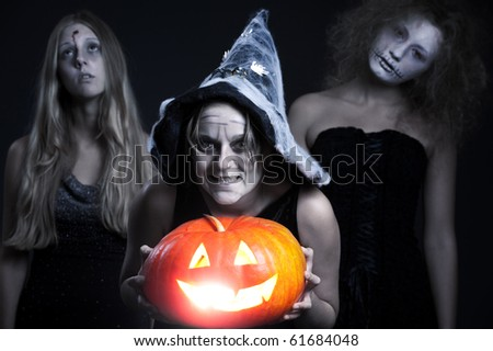 portrait of three halloween personages over dark background - stock photo