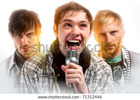 Portrait of three handsome musicians over white background - stock photo