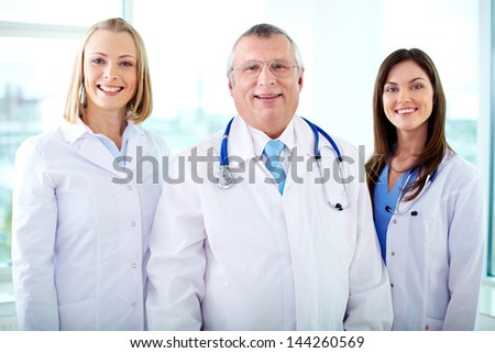Portrait of three happy therapeutists looking at camera