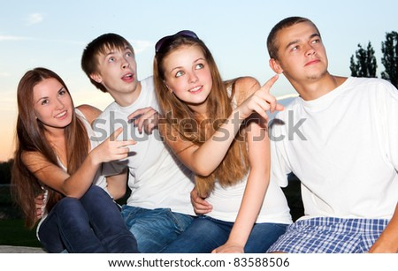 Portrait of three happy young teenagers - stock photo