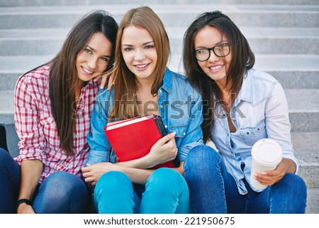 Portrait of three lovely female students - stock photo