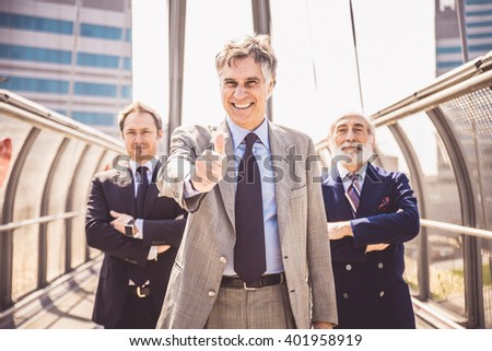 Portrait of three mature businessmen -  Senior business people looking confident at camera and smiling - stock photo
