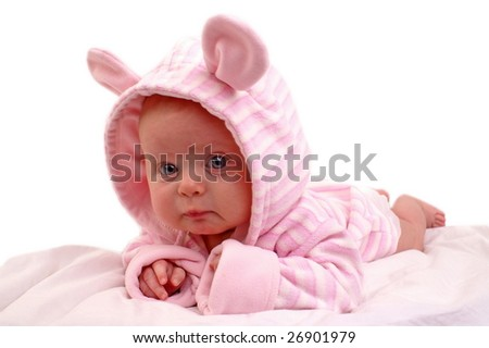 Portrait of three months old baby girl wearing pink hat