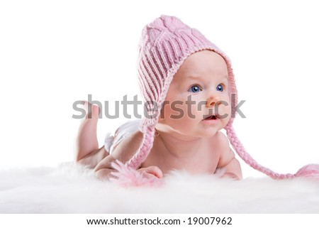 Portrait of three months old baby girl wearing pink winter hat - stock photo