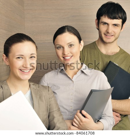 Portrait of three office workers. Office background. - stock photo