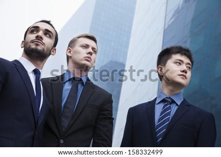 Portrait of three serious businessmen - stock photo