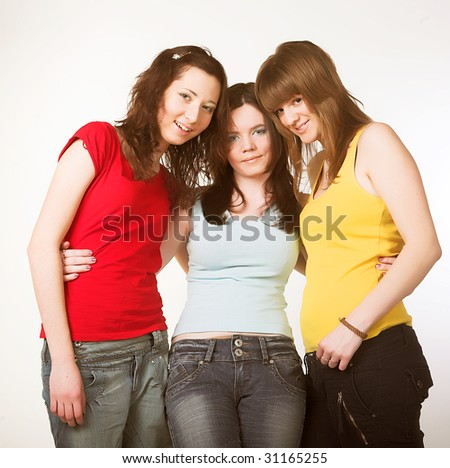Portrait of three smiling attractive girlfriends - stock photo