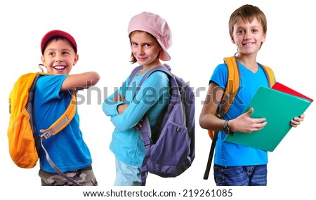 Portrait of three smiling pupils of grade school with backpacks and books posing. Isolated over white background. Education childhood concept - stock photo