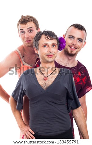 Portrait of three smiling transvestites cross-dressing, isolated on white background