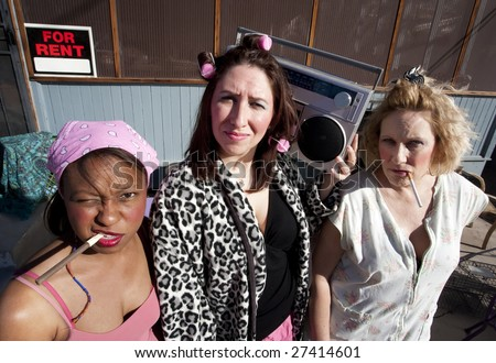 Portrait of three trashy women outdoors - stock photo