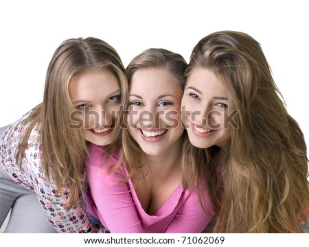 Portrait of three young beautiful happy girls - stock photo