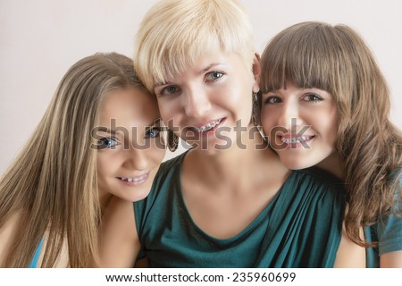 Portrait of Three Young Caucasian Girlfriends With Teeth Braces(Brackets). Horizontal Composition - stock photo