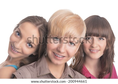Portrait of Three Young Ladies with Teeth Braces Together Isolated Over White. Horizontal Image - stock photo