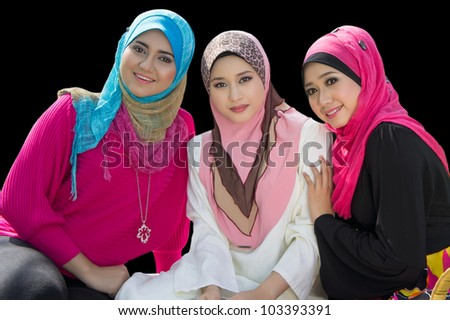 portrait of three young muslim girl - stock photo