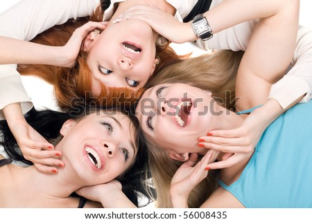 Portrait of three young smiling women on white background - stock photo
