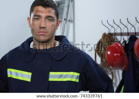 Portrait of tiered fireman standing in the office