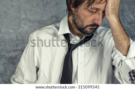 Portrait of tired exhausted businessman in trouble, problems in career - stock photo