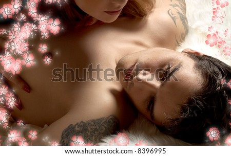 portrait of tired married man in bed with wife and flowers