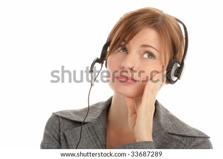Portrait of tired secretary/telephone operator wearing headset isolated over white background - stock photo
