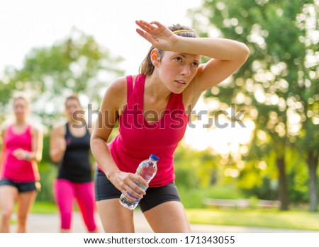portrait of tired woman after running on a hot summer's day - stock photo