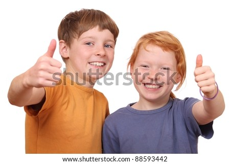 Portrait of to happy kids with thumbs up