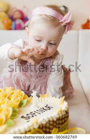 portrait of toddler girl with her birthday cake - stock photo