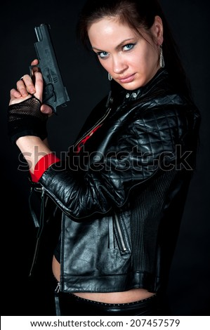 Portrait of tomb Raider style woman on black background - stock photo