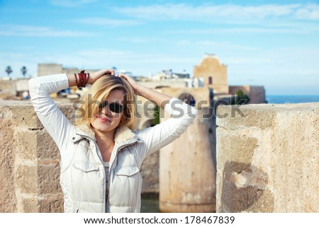 Portrait of tourist young adult girl outdoor,Morocco - stock photo
