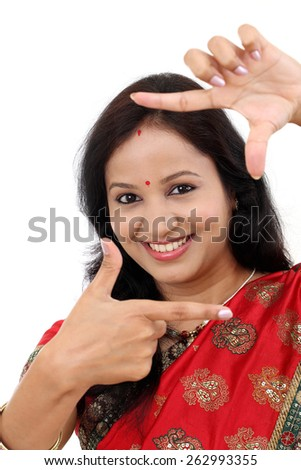 Portrait of traditional woman making frame with her hands - stock photo