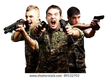 portrait of tree soldier aiming wearing  jungle camouflage against a white background - stock photo