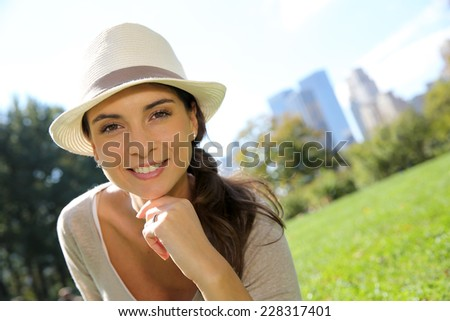 Portrait of trendy girl with hat in Central Park - stock photo