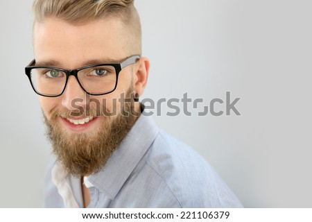 Portrait of trendy guy looking at camera, isolated - stock photo