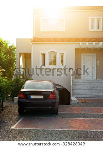 Portrait of tropical apartment building with car. - stock photo