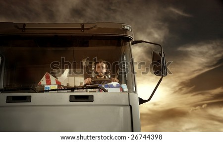Portrait of truck driver at the sunset - stock photo
