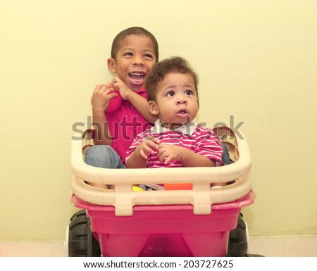 Portrait of two african boys inside a toy.  Focus in the front boy. - stock photo