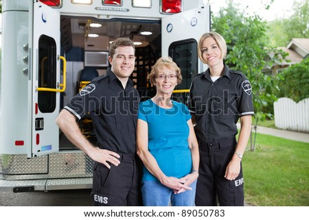Portrait of two ambulance with patient - stock photo