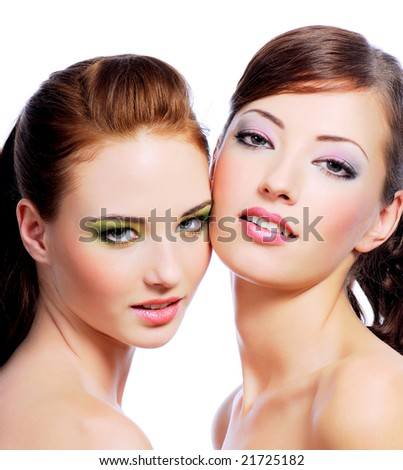 Portrait of two attractive young women with creativity hairstyle and stylish make-up - stock photo