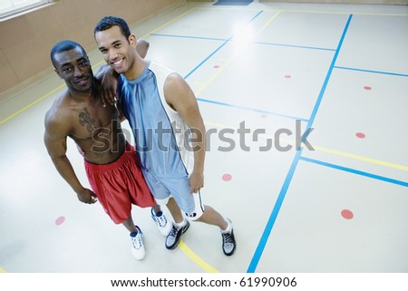 Portrait of two basketball players - stock photo