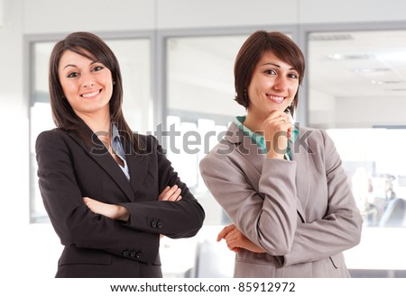 Portrait of two beautiful businesswomen in an office environment