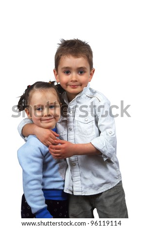 portrait of two beautiful children hugging a white background isolated