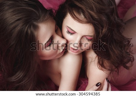 portrait of two beautiful girls with bright makeup studio