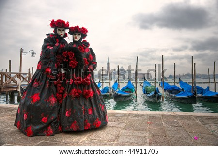 Portrait of two Beautiful masks in Venice, Italy. - stock photo