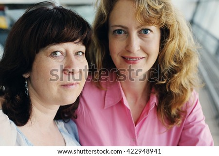 Portrait of two beautiful real 40 years old women